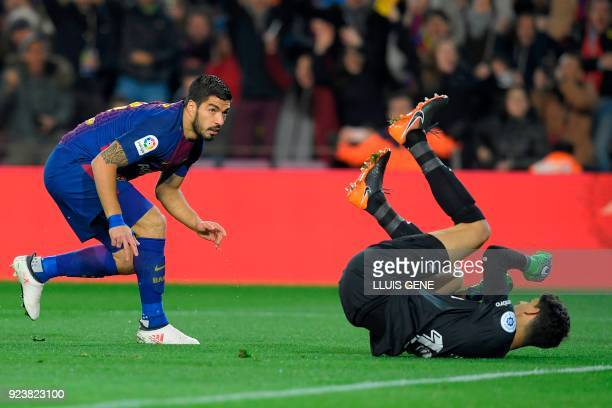 Barcelona's Uruguayan forward Luis Suarez scores against Girona's Moroccan goalkeeper Yassine Bounou during the Spanish league football match between...