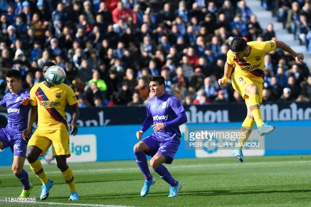 Barcelona's Uruguayan forward Luis Suarez scores during the Spanish league football match Club Deportivo Leganes SAD against FC Barcelona at the...