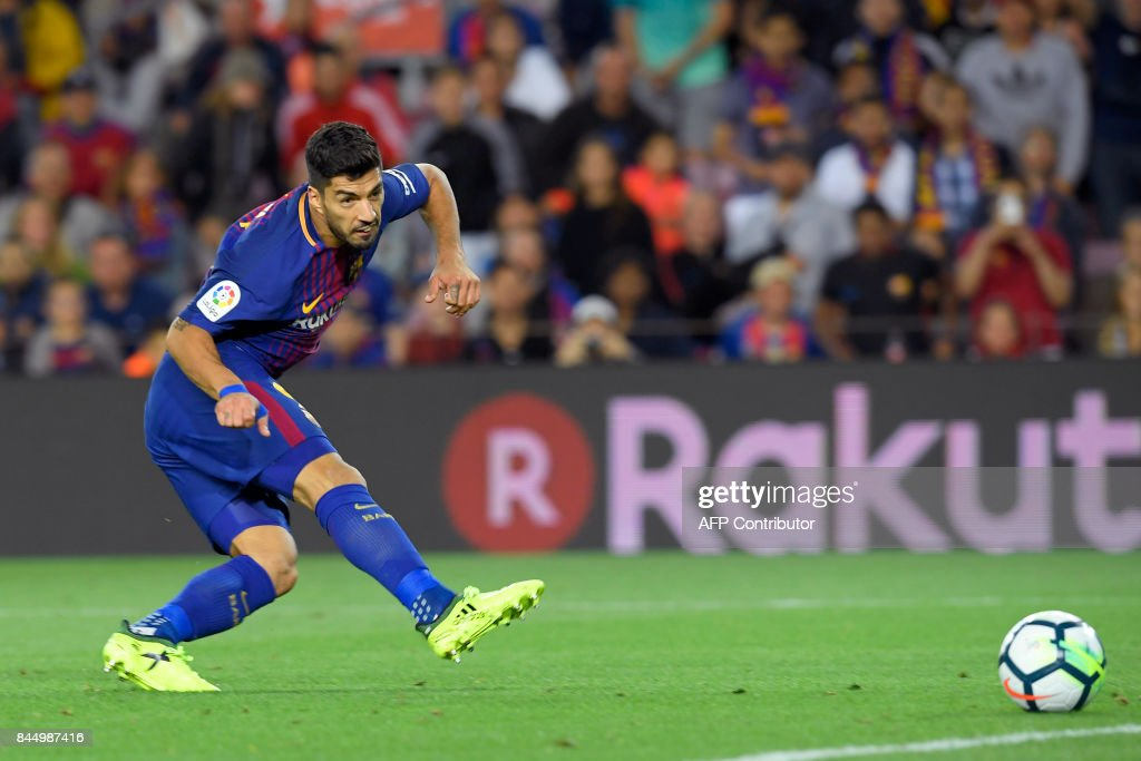 Barcelona's Uruguayan forward Luis Suarez scores during the Spanish Liga football match Barcelona vs Espanyol at the Camp Nou stadium in Barcelona on September 9, 2017. /