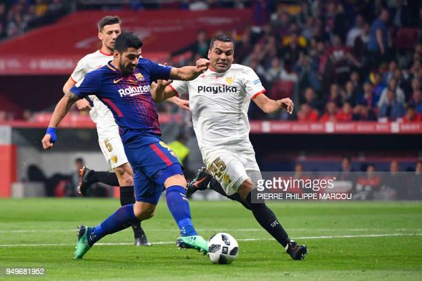Barcelona's Uruguayan forward Luis Suarez scores during the Spanish Copa del Rey final football match Sevilla FC against FC Barcelona at the Wanda...