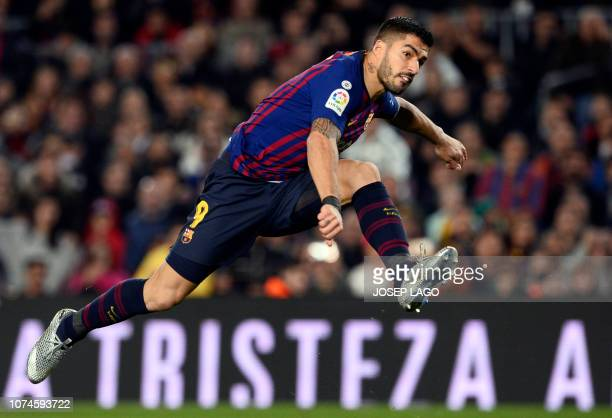Barcelona's Uruguayan forward Luis Suarez shoots during the Spanish League football match between FC Barcelona and RC Celta de Vigo at the Camp Nou...