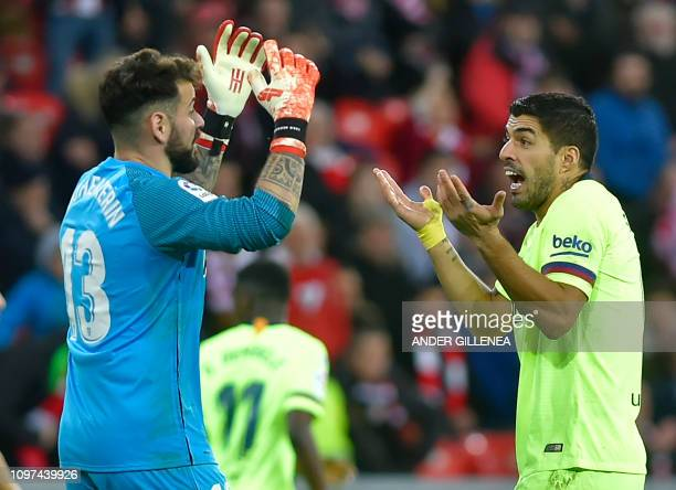 Barcelona's Uruguayan forward Luis Suarez speaks with Athletic Bilbao's Spanish goalkeeper Iago Herrerin during the Spanish league football match...