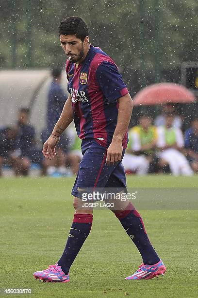 Barcelona's Uruguayan forward Luis Suarez spits during the friendly football match FC Barcelona B vs Indonesia Sub-19 national team at the Sports...