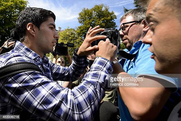 Barcelona's Uruguayan forward Luis Suarez tries to make his way leaving surrounded by journalists after he pleaded his case before the Court of...