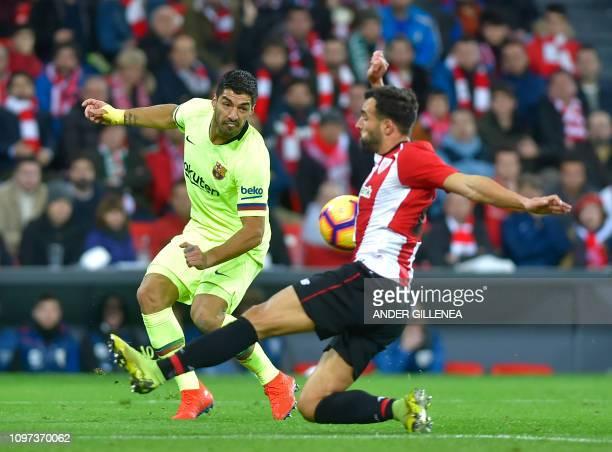 Barcelona's Uruguayan forward Luis Suarez vies with Athletic Bilbao's Spanish defender Mikel Balenciaga during the Spanish league football match...