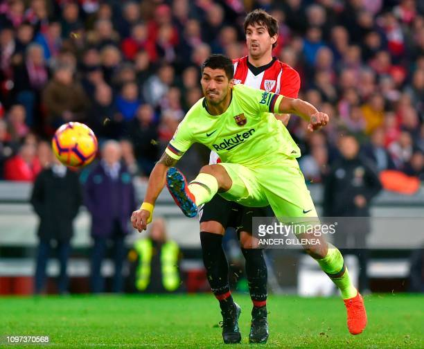 Barcelona's Uruguayan forward Luis Suarez vies with Athletic Bilbao's Spanish defender Mikel San Jose during the Spanish league football match...