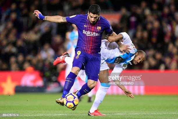 TOPSHOT Barcelona's Uruguayan forward Luis Suarez vies with Deportivo La Coruna's Brazilian defender Sidnei during the Spanish league football match...