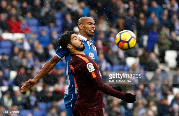 TOPSHOT Barcelona's Uruguayan forward Luis Suarez vies with Espanyol's Brazilian defender Naldo during the Spanish league football match between RCD...