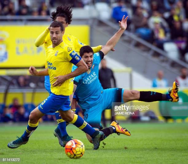 Barcelona's Uruguayan forward Luis Suarez vies with Las Palmas' defender David Garcia during the Spanish league football match UD Las Palmas vs FC...