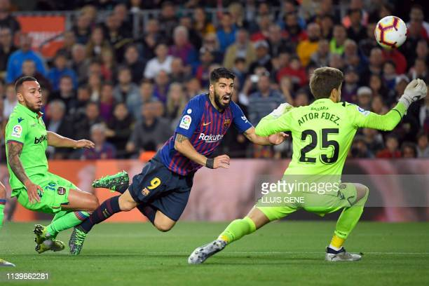 Barcelona's Uruguayan forward Luis Suarez vies with Levante's Spanish goalkeeper Aitor Fernandez during the Spanish League football match between FC...