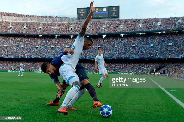 Barcelona's Uruguayan forward Luis Suarez vies with PSV Eindhoven's Dutch midfielder Pablo Rosario during the UEFA Champions' League group B football...