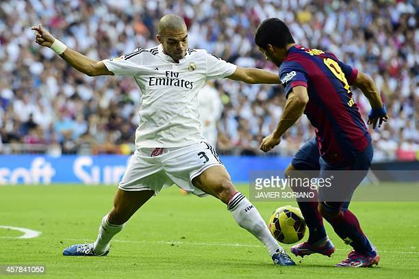 Barcelona's Uruguayan forward Luis Suarez vies with Real Madrid's Portuguese defender Pepe during the Spanish league football match Real Madrid CF vs...