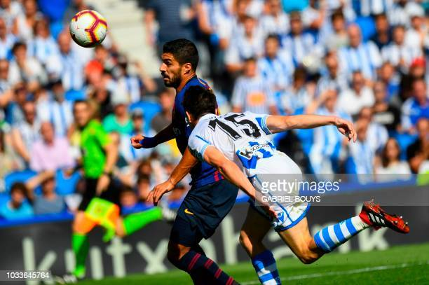 Barcelona's Uruguayan forward Luis Suarez vies with Real Sociedad's Spanish defender Aritz Elustondo during the Spanish league football match between...