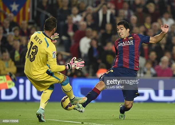 Barcelona's Uruguayan forward Luis Suarez vies with Sevilla's Portuguese goalkeeper Beto during the Spanish league football match FC Barcelona vs...