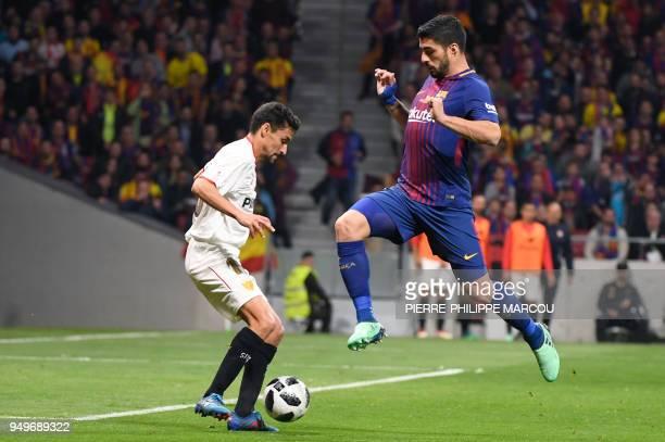 Barcelona's Uruguayan forward Luis Suarez vies with Sevilla's Spanish midfielder Jesus Navas during the Spanish Copa del Rey final football match...