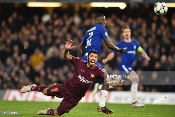 TOPSHOT Barcelona's Uruguayan striker Luis Suarez falls to the ground after a challenge from Chelsea's German defender Antonio Rudiger during the...
