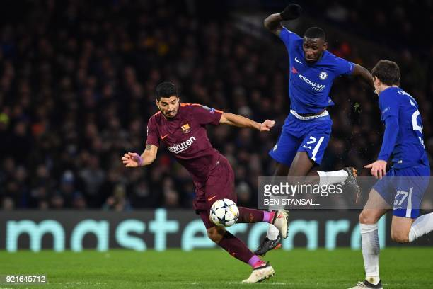 Barcelona's Uruguayan striker Luis Suarez falls to the ground after a challenge from Chelsea's German defender Antonio Rudiger during the first leg...