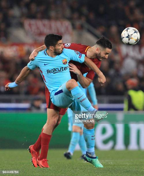 Barcelona's Uruguayan striker Luis Suarez fights for the ball with Roma's Greek defender Kostas Manolas during the UEFA Champions League quarterfinal...