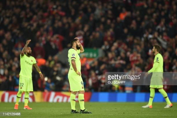 Barcelona's Uruguayan striker Luis Suarez reacts after Liverpool scored their third goal during the UEFA Champions league semifinal second leg...