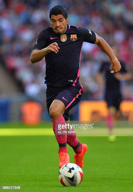 Barcelona's Uruguayan striker Luis Suarez runs with the ball during the preseason International Champions Cup football match between Spanish...