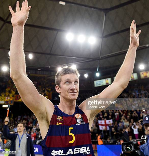 Barcelona's US forward Justin Doellman celebrates their victory at the end of the Euroleague group F top 16 round 10 basketball match FC Barcelona...