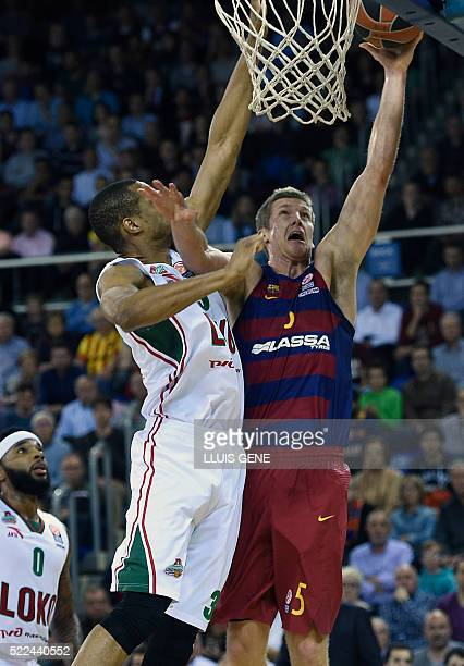 Barcelona's US forward Justin Doellman vies with Lokomotiv's US forward Anthony Randolph during the Euroleague Game 3 playoff match FC Barcelona vs...