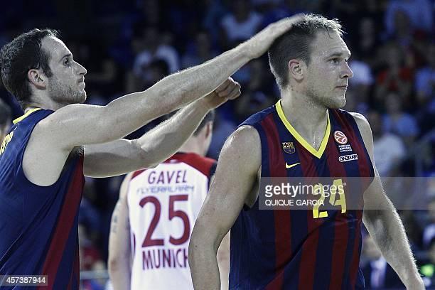 Barcelona's US guard Bardley Scott Oleson is congratuled by Barcelona's Brazilian guard Marcelinho Huertas during the Euroleague group D basketball...