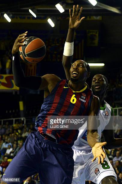 Barcelona's US guard Joey Dorsey vies with Nanterre's center Mam Jaiteh during the Euroleague basketball match FC Barcelona vs JSF Nanterre at the...