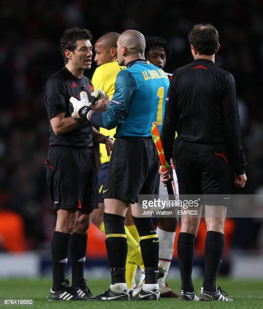 Barcelona's Victor Valdes has words with the referee Massimo Busacca after the game