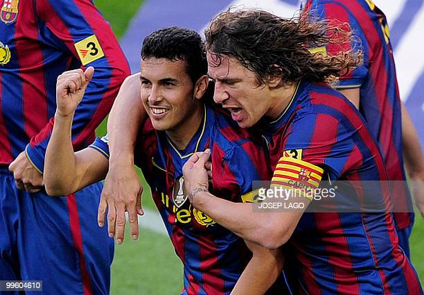 Barcelonas«s forward Pedro Rodriguez is congratuled by his teammate capitain Carles Puyol after scoring during a Spanish League football match...
