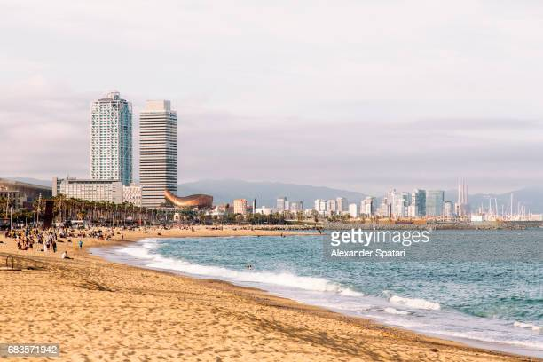 barceloneta beach and barcelona city skyline, barcelona, catalonia, spain - la barceloneta stock pictures, royalty-free photos & images