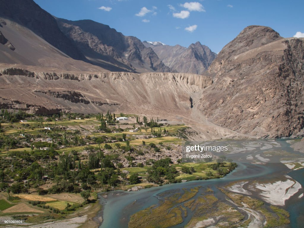 Barchadiv (aka Barchadiev) village on the bank of Murghab river in Bartang valley in the Pamirs, Tajikistan : Stock Photo