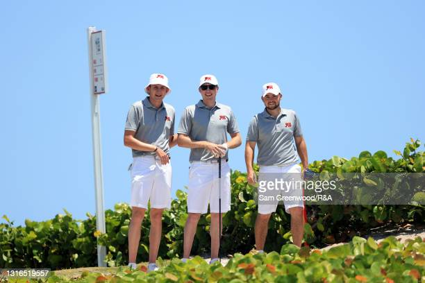 Barclay Brown, Mark Power, and Alex Fitzpatrick of the Great Britain and Ireland Walker Cup team walk down the 18th hole during a practice day prior...