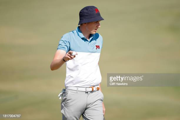 Barclay Brown of Team Great Britain and Ireland reacts after his putt on the second green during Saturday singles matches of Day One of The Walker...