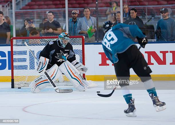 Barclay Goodrow and Alex Stalock of the San Jose Sharks get loose with shots on net a day before the game against the Los Angeles Kings during the...