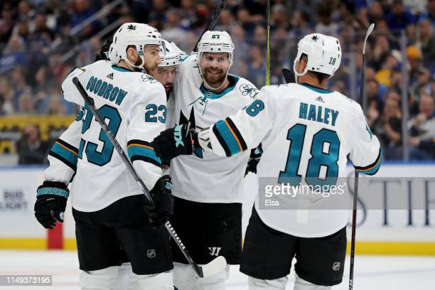 Barclay Goodrow Brenden Dillon Joonas Donskoi and Micheal Haley of the San Jose Sharks celebrate a goal scored by Erik Karlsson against the St Louis...