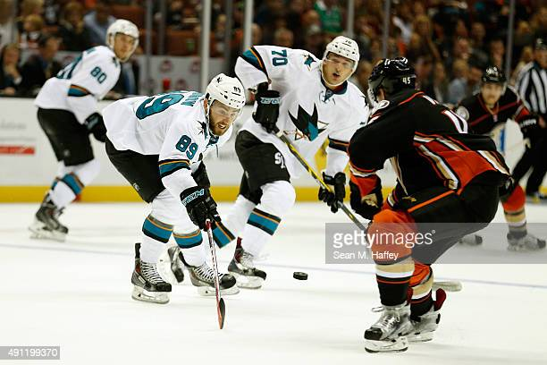 Barclay Goodrow of the San Jose Sharks and Gus Young of the San Jose Sharks skate with the puck in the second period of a preseason game against the...