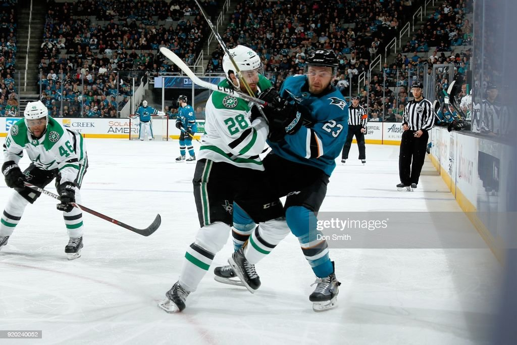 Barclay Goodrow #23 of the San Jose Sharks and Stephen Johns #28 of the Dallas Stars battle on the ice at SAP Center on February 18, 2018 in San Jose, California.