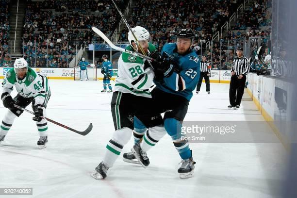 Barclay Goodrow of the San Jose Sharks and Stephen Johns of the Dallas Stars battle on the ice at SAP Center on February 18 2018 in San Jose...