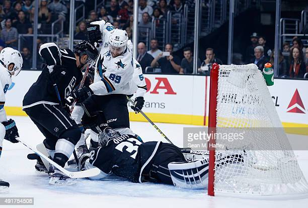 Barclay Goodrow of the San Jose Sharks can't get his stick on the puck asJonathan Quick of the Los Angeles Kings and Alec Martinez of the Los Angeles...