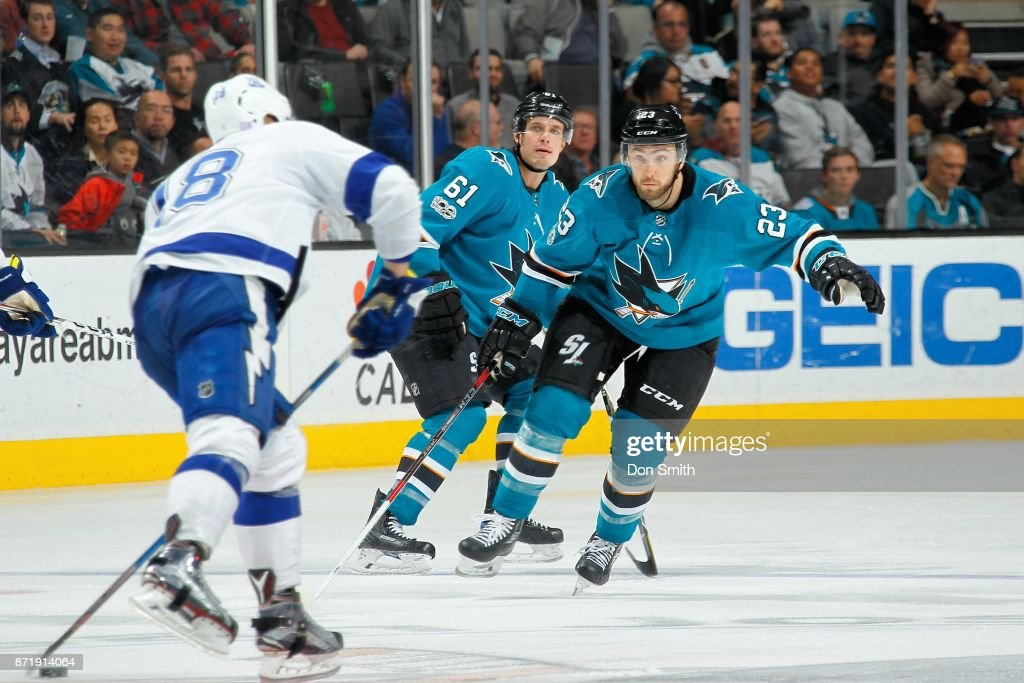 Barclay Goodrow #23 of the San Jose Sharks defends Ondrej Palat #18 of the Tampa Bay Lightning at SAP Center on November 8, 2017 in San Jose, California.