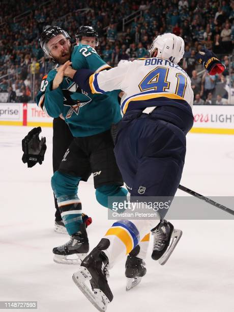 Barclay Goodrow of the San Jose Sharks fights with Robert Bortuzzo of the St Louis Blues in Game One NHL Western Conference Final during the 2019 NHL...