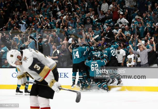 Barclay Goodrow of the San Jose Sharks is congratulated by teammates as Brayden McNabb of the Vegas Golden Knights skates off the ice after he scored...