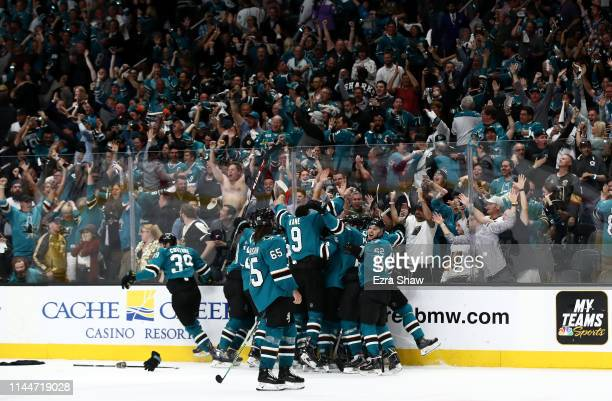 Barclay Goodrow of the San Jose Sharks is congratulated by teammates after he scored the game winning goal in overtime against the Vegas Golden...