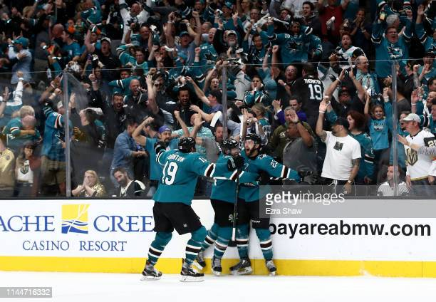 Barclay Goodrow of the San Jose Sharks is congratulated by MarcEdouard Vlasic and Joe Thornton of the San Jose Sharks after he scored the game...