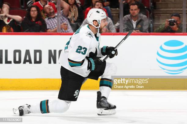 Barclay Goodrow of the San Jose Sharks reacts after scoring the gamewinning goal against the Chicago Blackhawks in the third period at the United...