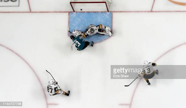 Barclay Goodrow of the San Jose Sharks scores the gamewinning goal against MarcAndre Fleury of the Vegas Golden Knights in overtime in Game Seven of...