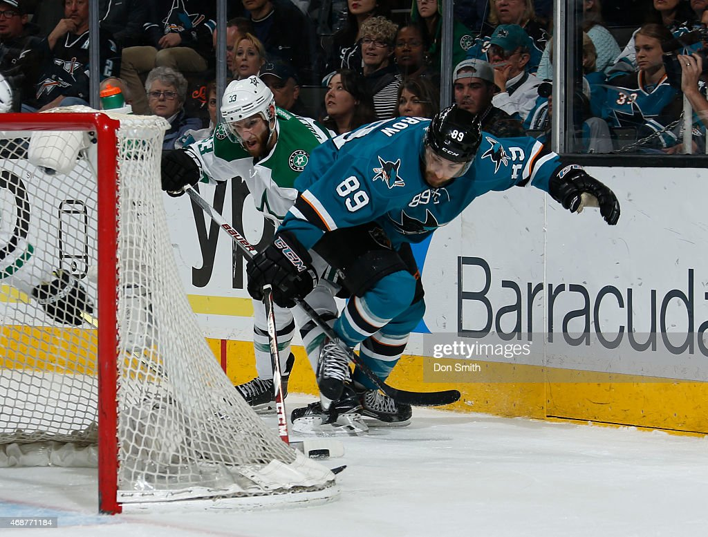 Barclay Goodrow #89 of the San Jose Sharks skates after the puck against Alex Goligoski #33 of the Dallas Stars at the SAP Center on April 6, 2015 in San Jose, California .