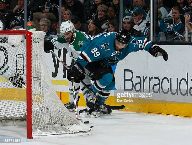 Barclay Goodrow of the San Jose Sharks skates after the puck against Alex Goligoski of the Dallas Stars at the SAP Center on April 6 2015 in San Jose...