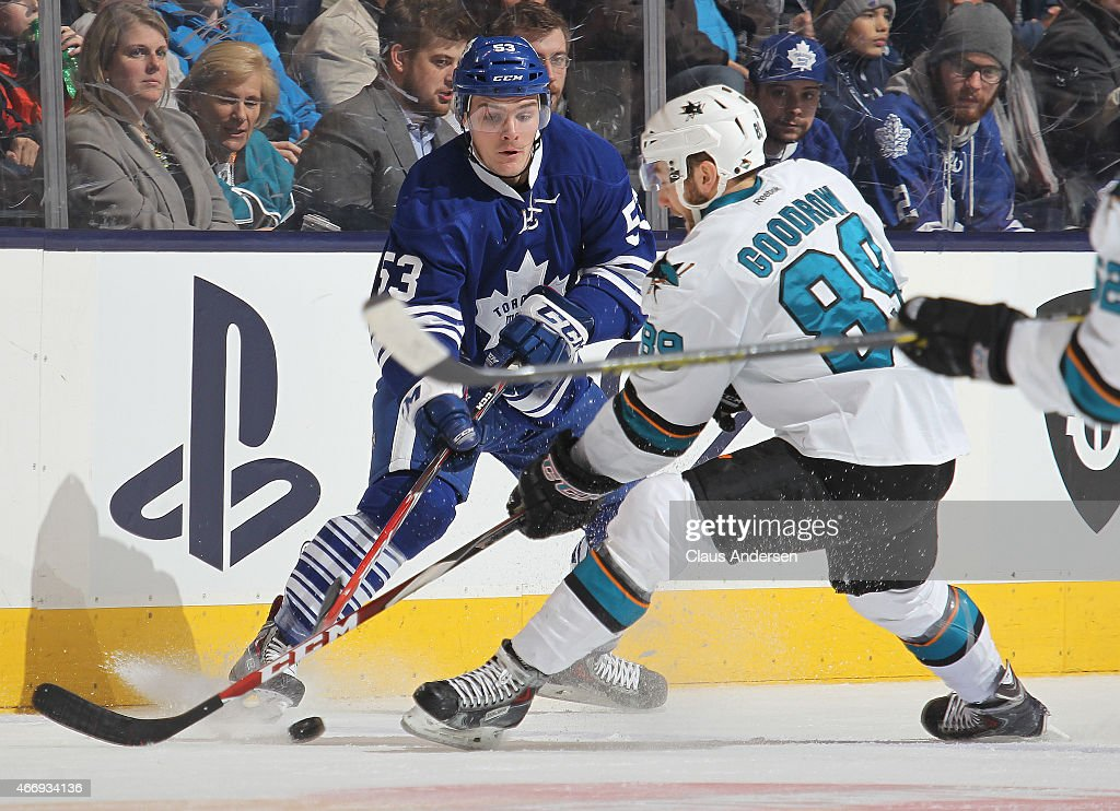 Barclay Goodrow #89 of the San Jose Sharks skates against Sam Carrick #53 of the Toronto Maple Leafs during an NHL game at the Air Canada Centre on March 19, 2015 in Toronto, Ontario, Canada.